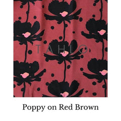 Fabric swatch of a poppy on brown