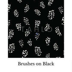 Brushes on black fabric swatch