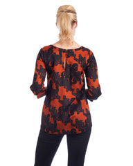 Keyhole feature at the back of the neckline in this silk blouse