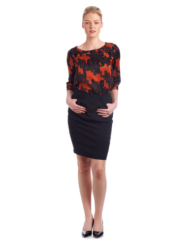 Why not tuck you silk blouse with keyhole detail in to a pencil skirt for stylish workwear