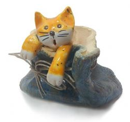 Pottery Cat in a metalic coloured sack