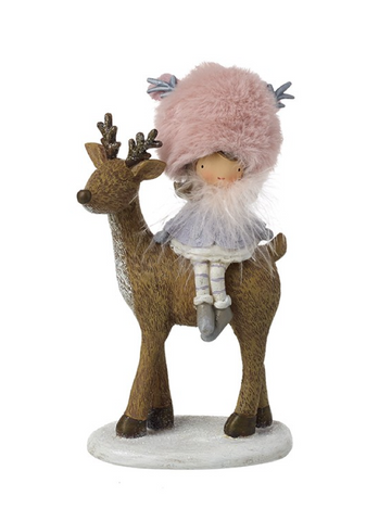 Heaven Sends. Girl With Pink Fur Hat Sitting on Reindeer