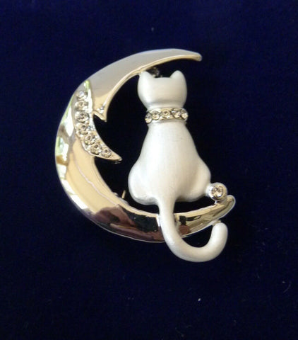 Rodney Holman: Brooch: White Cat Sitting on Moon