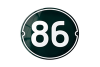 86 white on green house number sign
