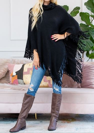 Black turtleneck poncho with a fringe trim