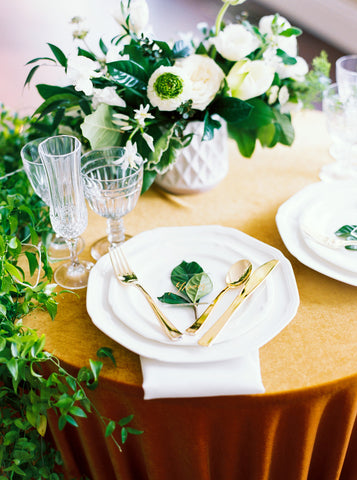 gold velvet tablecloth greenery florals