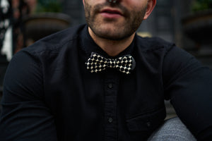 Image of the bugsy black and white bow tie posing for Father's Day blog.