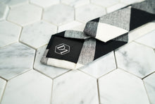 The back Dear Martian, argyle tie portrays a hand stitched DM hexagonal logo on the tipping.