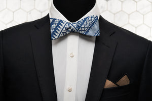 An image of a Dear Martian mannequin dressed in our aztec blue self tie bow tie and rocking our stylish brown arbuckle pocket square.