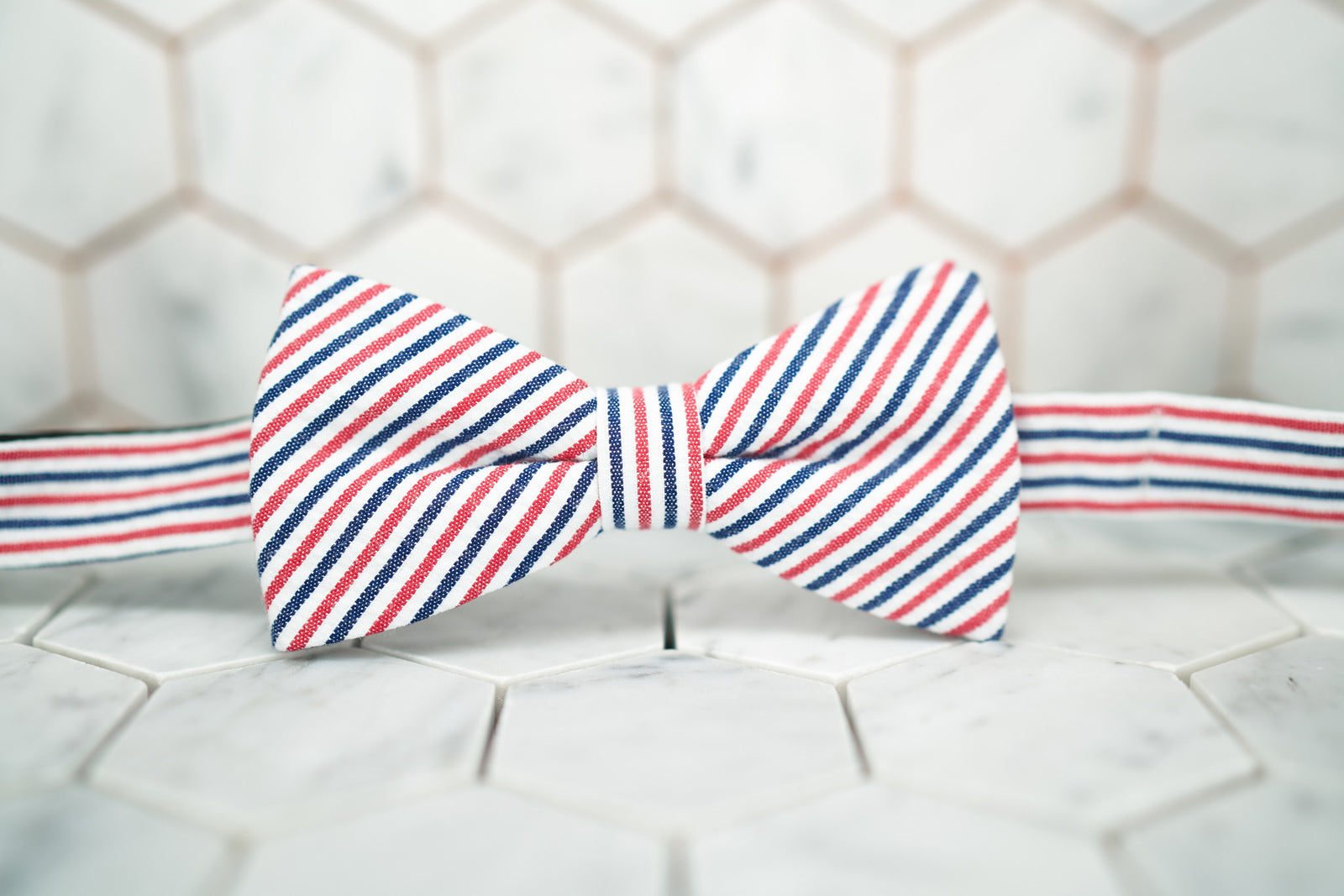 A beautifully handmade patriotic seersucker bow tie by Dear Martian.