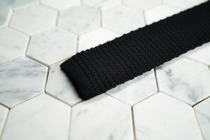 A detailed close up shot of the Dear Martian, Crow Hill black silk men's tie.