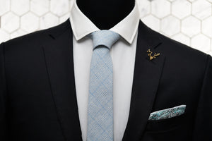 A dapper display of the Dear Martian, Tiffany blue blended tie paired with the Whitman pocket square and gold stag lapel pin.