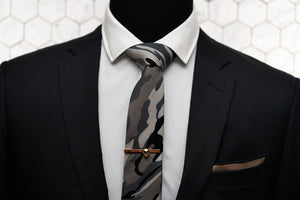 An image showing how Dear Martian's Fort Hamilton tie can be paired up with other men's accessories such as the Vie gold skull tie clip and Arbuckle brown linen pocket square.