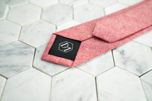 The back of Dear Martian's chambray red skinny tie, featuring our DM logo tipping.
