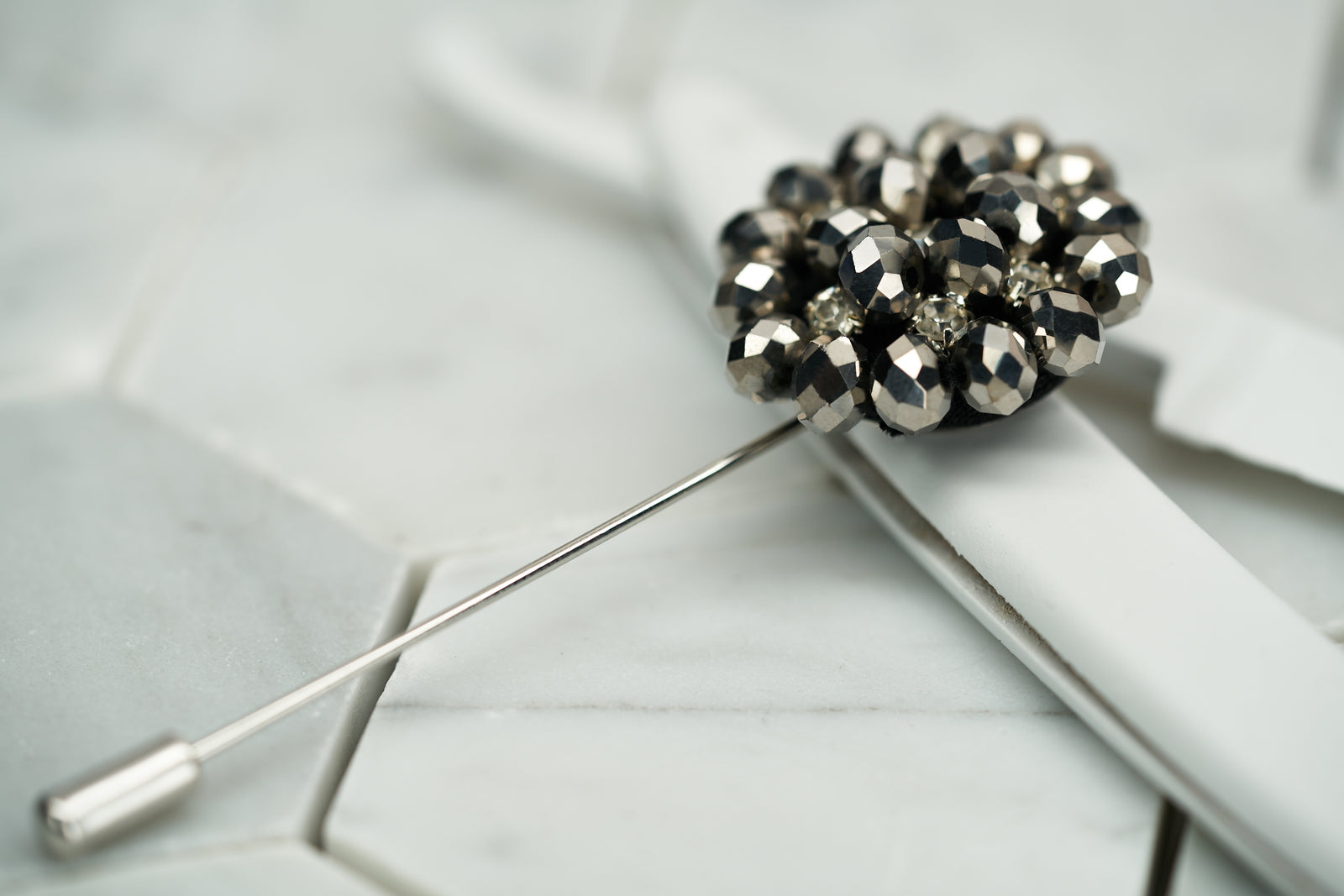 Front image of the Dear Martian beaded grey lapel pin, which has rhinestones for a shimmery effect.