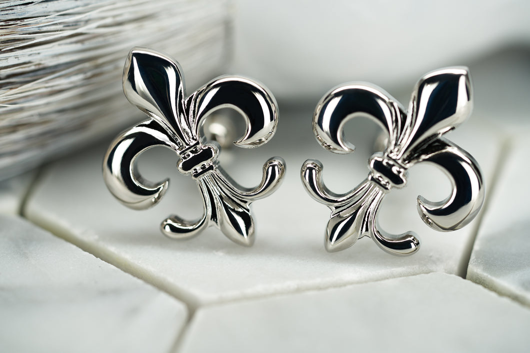 A product image featuring the silver pair of fleur de lis cufflinks by Dear Martian, named Carroll.