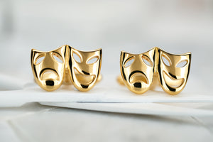 An image of Dear Martian gold plated theater mask cufflinks.