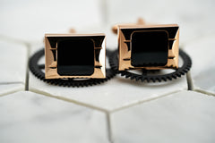 A product image of the rose gold Carre square enamel cufflinks for men by Dear Martian, Brooklyn.