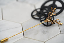 An image of an antique gold stag lapel pin by Dear Martian, Brooklyn.