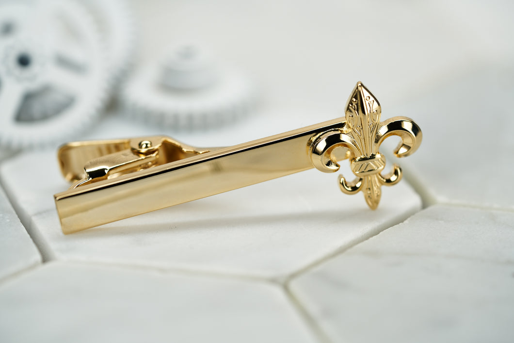 The front image of the Dear Martian Caroll Fleur De Lis gold tie bar.