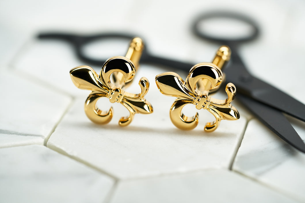 The front image of Dear Martian's gold plated fleur de lis cufflinks for men.