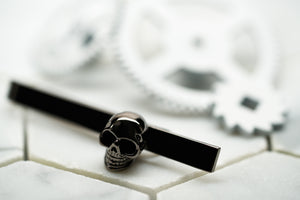 An image of a gunmetal mens skull tie bar by Dear Martian, BKYLN.