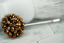 Front image of the copper tone beaded suit lapel pin by Dear Martian, which features rhinestones for an extra shine.