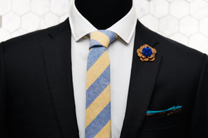 A mannequin is dressed in Dear Martian's menswear; a yellow striped linen necktie , floral pocket square, and wooden flower lapel pin.