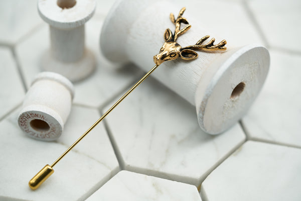 An image of the Dear Martian vintage gold stag lapel pin by Dear Martian.