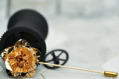 A product image of the rose gold rose shaped flower lapel hat pin by Dear Martian, Brooklyn