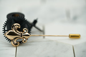 An side view product image of the Carroll gold plated fleur de lis lapel pin by Dear Martian, Brooklyn.