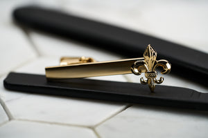 A front image of the DM Brooklyn gold plated flower of life tie clip for men.
