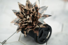 An image of the cheetah patterned boutonniere by Dear Martian.