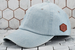 The front view image of the Dear Martian minimal dad hat, which features a brown leather patch on the side panel.