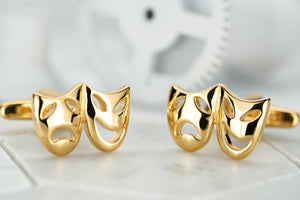 An image of a pair of Dear Martian gold costume mask cufflink accessories for men.