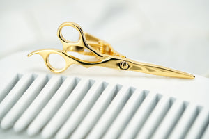An image of the gold plated fleet street scissor tie clip.