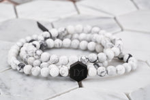 An image of the White Widow multi wrap bead bracelet made with white howlite chakra stone beads.