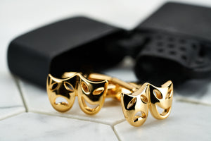 An image of gold plated brass vintage tragedy and comedy mask cufflinks by Dear Martian.