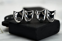 An image of a pair of steel plated theater mask cufflinks by Dear Martian.