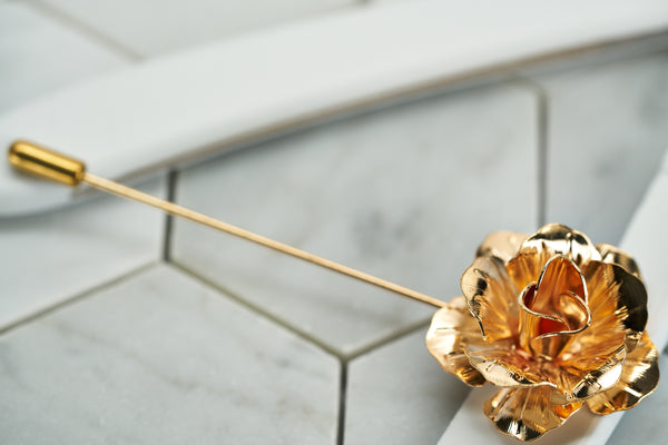 A side view image of the rose gold floral suit lapel pin by Dear Martian, Brooklyn.