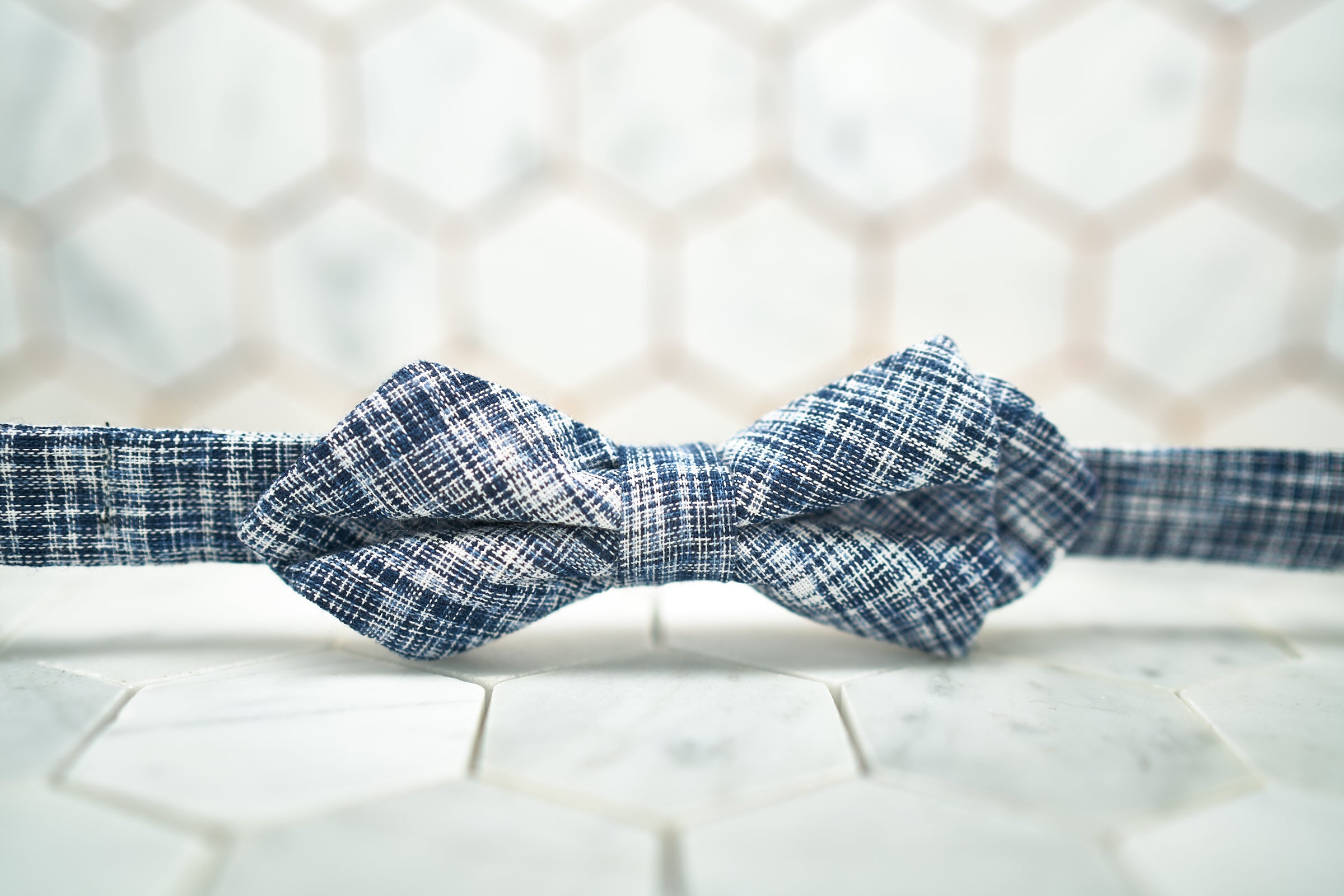 A front image the Dear Martian, Brooklyn pratt diamond pointed bow tie, which features a navy background.