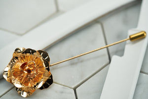 A front view image of the DM Brooklyn rose suit boutonniere pin.