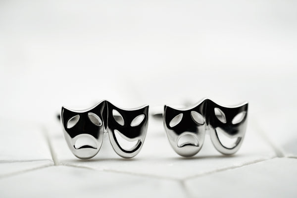 An image of a pair of theatre mask cufflinks for men by Dear Martian, BKLYN.