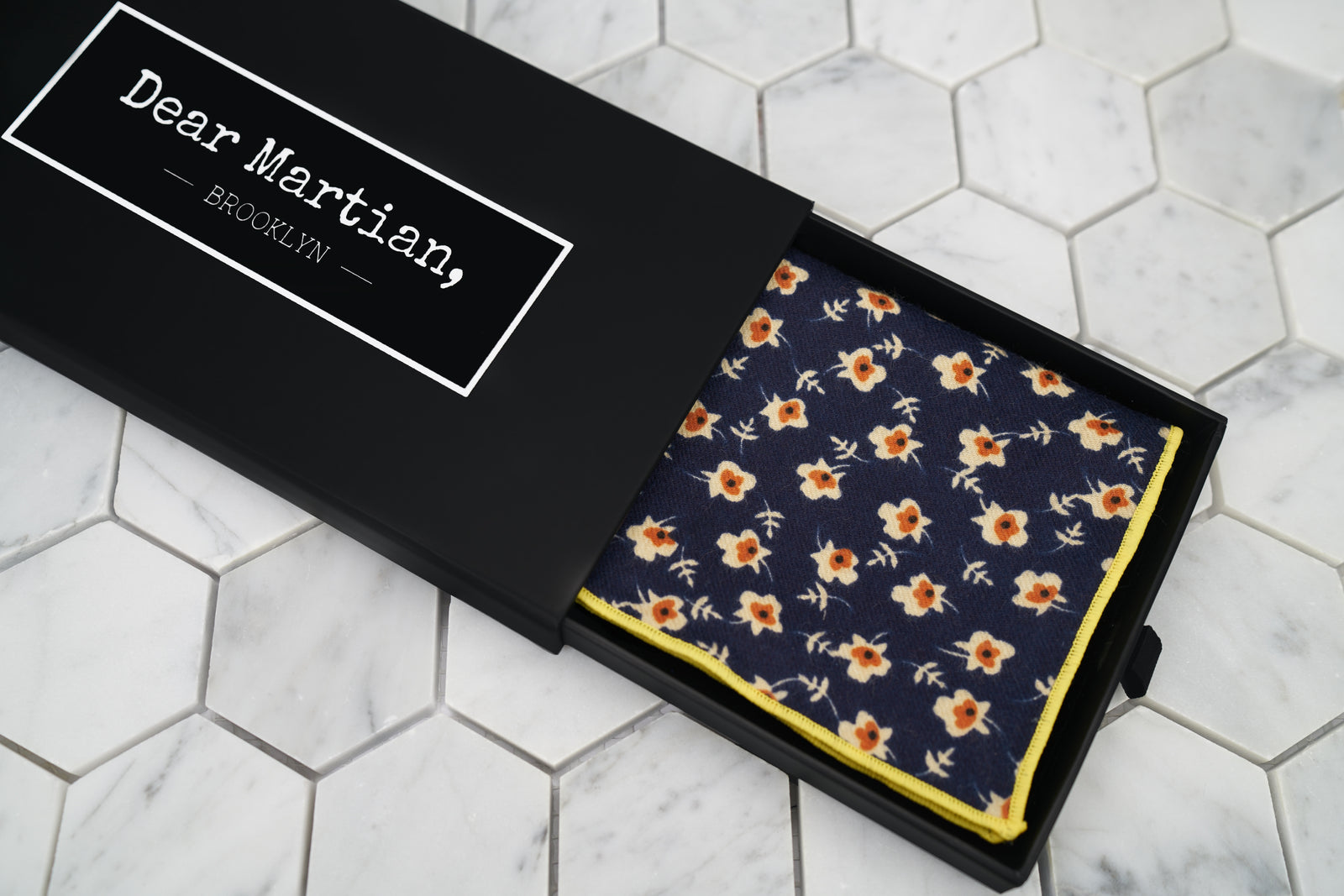 An image of the Dear Martian, Brooklyn black pull-out style box. Inside the box is our sunny eyed floral handkerchief.