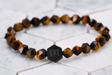 An image of the Bengal Tiger Eye chakra stone bracelet by Dear Martian.