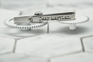 A back view image of the steel Vie skull tie bar, which features the Dear Martian logo etching.