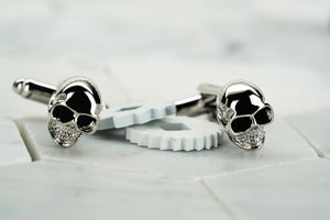 A front image of the Vie handmade silver skull cufflinks from Dear Martian accessories.