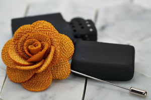 An image of the handmade Dear Martian, yellow brick road knitted flower lapel pin.
