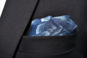 A black suit jacket pocket is stuffed with Dear Martian's Cranford rose denim pocket square.