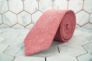 An image of the Haskins Townsend coral red necktie made by Dear Martian.